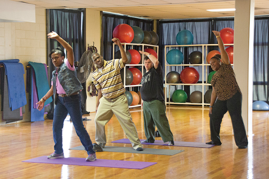 Community Access program participants enjoy a yoga class