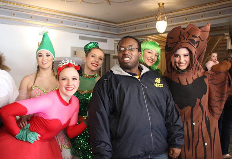 Program participant posing with Wizard of Oz actors at the Lucas Theater in Savannah, GA